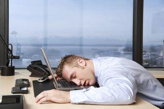 Man Sleeping at Computer